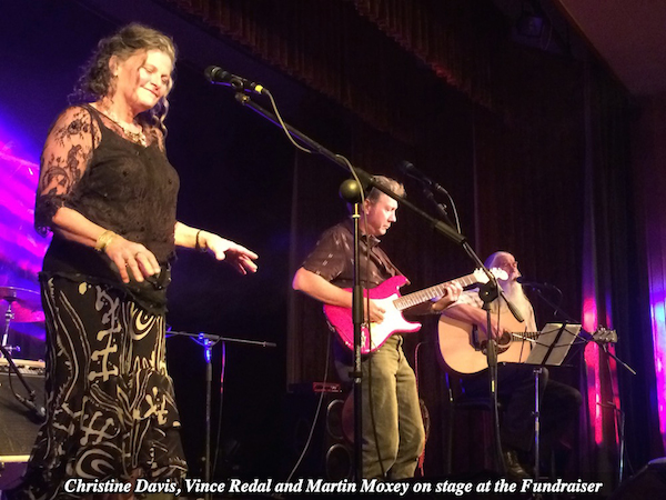 Christine Davis, Vince Redal and Martin Moxey on stage at the Fundraiser