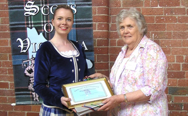 2015 Ian Murdoch Memorial Award winner Heather Bell receiving the Award from Mrs Helen Murdoch