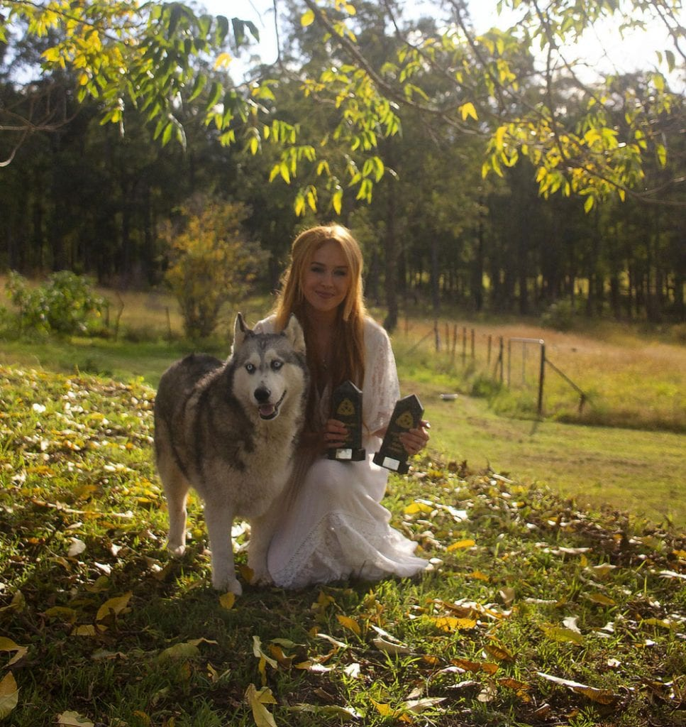 Ella Roberts pictured with Evie, the wolf. Photo credit Fraser McKenzie.